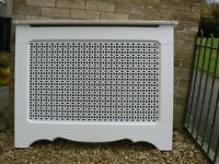 Radiator Cabinet. White MDF with cross grill pattern front and top shelf.