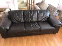 Brown leather sofa and arm chair