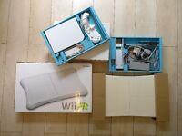 Nintendo Wii + balance board + games
