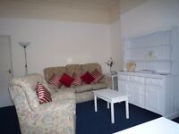 NO FEES! Spaceous F/Furnished one bed flat. RENT INCLUDES WATER AND VIRGIN B/Band.