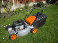 Flymo petrol lawnmower.