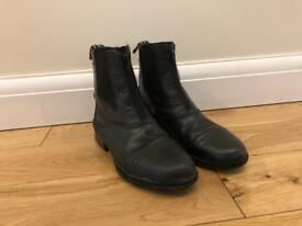 Black leather ankle high riding boots