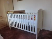 Childs TUTTI BAMBINI cot, white ,drop side, can be adjusted to different levels.Converts to a bed