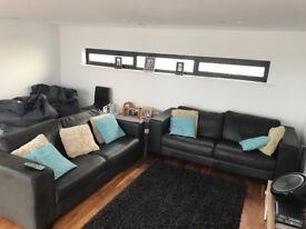 Genuine Italian black leather sofas
