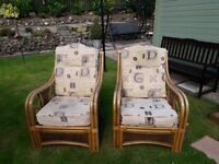 Two wicker/cane chairs