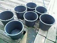 7!large planters/heavy duty plastic/handles and holed for drainage