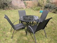 Patio/Garden Furniture Set - 4 Chairs, Glass topped Table and Parasol - Excellent Condition