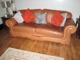 Tan Leather settee and two arm chairs