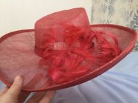 Coral sinnamay hat, with feather detail, ideal for wedding or races