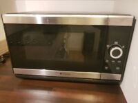 Black and silver hotpoint microwave
