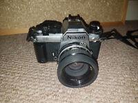 Nikon FA 50mm camera and lens.