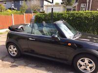Black convertible mini one, see description.