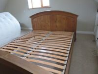 Pine kingsize bed with a slatted base.
