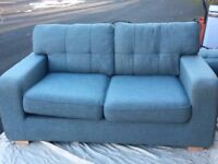 2 X large 2 seater matching Sofas - 1 is a sofa bed