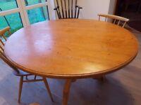 circular pine flip top table