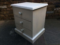 White bedside table with three drawers