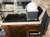 Kitcken sink and storage good condition