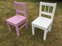 Two children's wooden chairs in purple and white