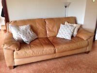 Large tan leather sofa
