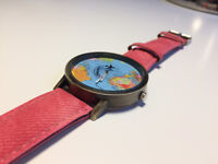 Women's watch with washed red coloured strap -excellent condition