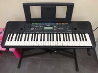 Black Yamaha keyboard nearly new