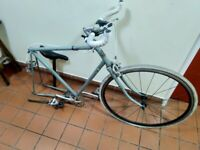 Old single speed bike with missing wheel, seat post and inner tubes medium central London