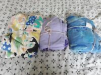 3 single duvet covers with p/case. Clean. Suit childs bed. One blue.one purple.one multi print.