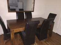 dining table and six leather chairs