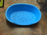 Blue hard plastic dog bed