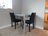 Glass extendable table and 2 chairs