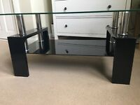 Glass top table, great for any wanted use and in good condition.