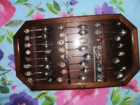 spoon collection and glass front mahogany cabinet