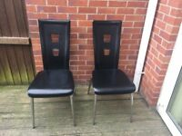 2 Used Black Leather Dining Chairs With Stainless Steel Legs