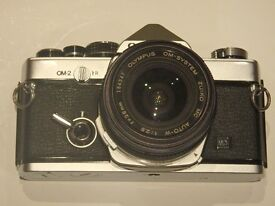 Olympus OM-2 classic 35mm film camera with 28mm lens