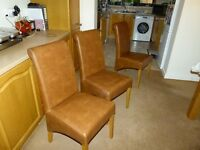 6 leather effect dining chairs in tan