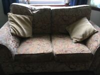 Paisley pattern 2 seater sofa in good condition with 2 cushions