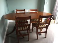 Large wooden dining table and 4 chairs