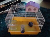 Hamster starter cage with wheel food bowl etc.