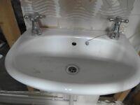 Small clakroom wash basin and larger pedestal wash basin.