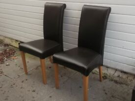 High backed brown leather chairs