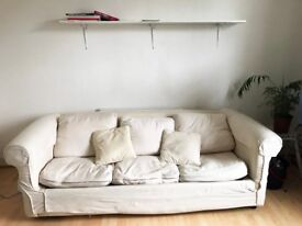 White, three seater sofa with removable covers and feather pillows!