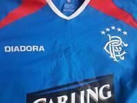 Signed Novo Rangers FC top
