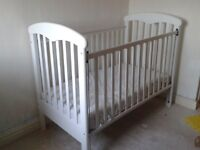 Mammas and Papas cot in good condition with minor scuffs. Mattress included.
