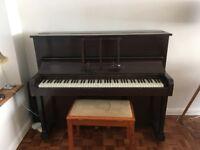 Upright 'Firth Bros Edmonton' dark wood piano and tan wood piano stool.