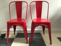 Two red metal chairs
