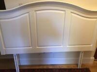 White wooden double headboard
