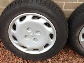 2 winter Goodyear tyres and rims 185/65 R14