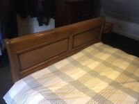 Grand antique wooden slay double bed.
