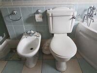 Porcelain toilet, bidet, shower tray and enclosure.