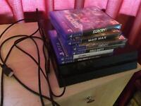 Playstation 4 with all cables and six games